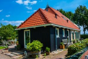Verbouw dakrenovatie woonboerderij in Sintjohannesga
